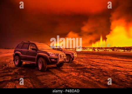 SUVs close to the Eruption at Holuhraun, near the Bardarbunga Volcano, Iceland. August 29, 2014 a fissure eruption started in Holuhraun at the northern end of a magma intrusion, which had moved progressively north, from the Bardarbunga volcano. Picture Date-Sept. 2, 2014 - Stock Photo