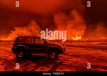 SUV close to the Eruption at Holuhraun, near the Bardarbunga Volcano, Iceland. August 29, 2014 a fissure eruption started in Holuhraun at the northern end of a magma intrusion, which had moved progressively north, from the Bardarbunga volcano. Picture Date-Sept. 2, 2014 - Stock Photo