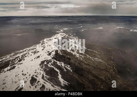 Dust storms over lava fields by Holuhraun. August 29, 2014 a fissure eruption started in Holuhraun at the northern end of a magma intrusion, which had moved progressively north, from the Bardarbunga volcano. Bardarbunga is a stratovolcano located under Vatnajokull, Iceland's most extensive glacier. - Stock Photo