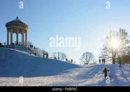 München, Munich, children, kids, sledding, sleigh, sled, sledge, Monopteros in the Englischer Garten (English Garden), Upper Bavaria, Bavaria, Germany - Stock Photo
