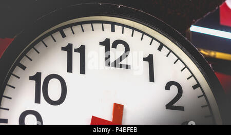 closeup of an old dusty and damaged train station clock in Italy - Stock Photo