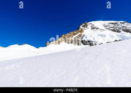 Moench mountain - View of the mountain Moench in the Bernese Alps in Switzerland - travel destination in Europe - Stock Photo