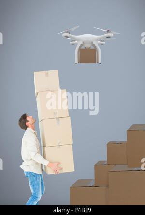 Man lifting delivery parcels stacked up to drone flying - Stock Photo