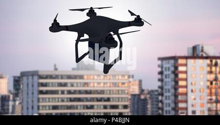 Drone flying over city - Stock Photo