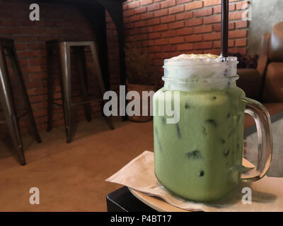 Green tea iced frappe in bakery vintage style. - Stock Photo
