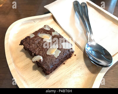 Brownie one piece on wood dish in the cafe. - Stock Photo