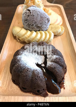 Chocolate lava with chocolate ice cream set in the cafe. - Stock Photo