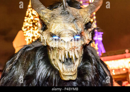 Vienna, mask procession Perchtenlauf (Perchten run) with Krampus in the Prater, Christmas market, Ferris wheel, 02. Leopoldstadt, Wien, Austria - Stock Photo