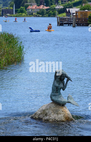 Seeboden am Millstätter See, exit stream Seebach of Millstätter See (Lake Millstatt), statue of mermaid, bathers, Kärnten, Carinthia, Austria - Stock Photo