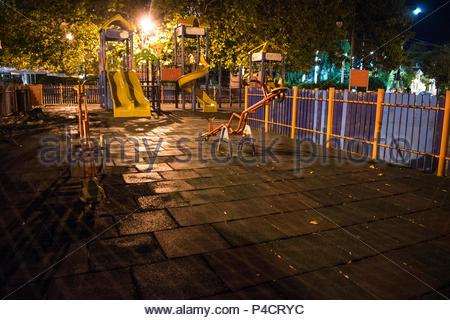 Late summer night at children's playground in Varna - the sea capital of Bulgaria. - Stock Photo