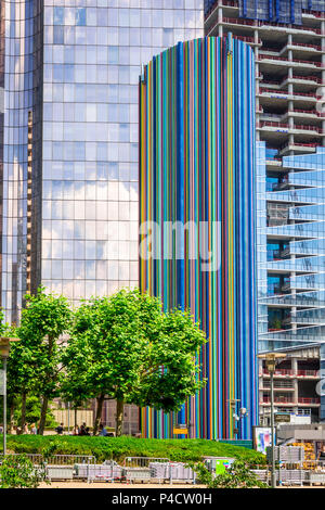 'Le Moretti' by Raymond Moretti is made from 642 colour tubes to cover a monumental chimney and sits at the La Defense area in Paris, France - Stock Photo