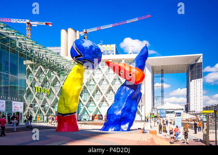 'Personnages Fantastiques' is a colourful outdoor artwork and represent two dancers playing together amongst the high-rises at La Defense,Paris, Stock Photo