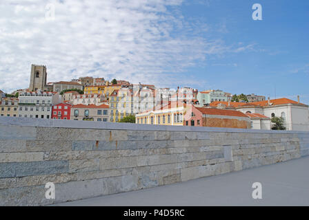 Lisbon's Alfama district viewed from the riverside. - Stock Photo