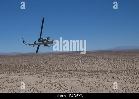 "An AH-1W SuperCobra, with Marine Light Attack Helicopter Squadron 775, Marine Aircraft Group 41, 4th Marine Aircraft Wing, performs a break turn after conducting a close air support mission, during Integrated Training Exercise 4-18 at Marine Corps Air Ground Combat Center Twentynine Palms, Calif., June 18, 2018. HMLA-775, also known as the ""Coyotes,' provided air combat element support to Marine Air Ground Task Force 23 during ITX 4-18. (U.S. Marine Corps photo by Lance Cpl. Samantha Schwoch/released) - Stock Photo"