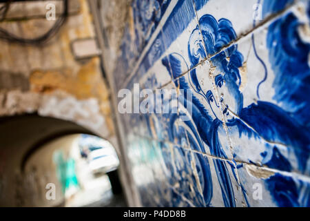 An angel figure in azulejo tiles in an alley in Lisbon, Portugal - Stock Photo