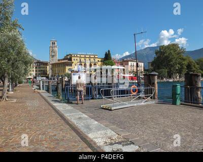 Riva Del Garda, Italy - September 10, 2014: The busy small port at Riva where the cruises come  and go from Lake garda Italy - Stock Photo