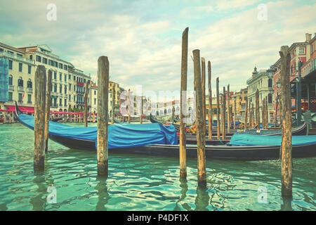 The Grand Canal near Rialto bridge in Venice with moored gondolas, Italy. Vintage style - Stock Photo