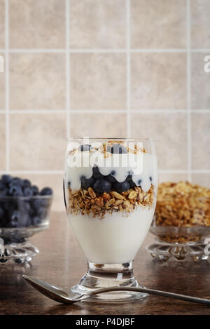 blueberry parfait with berries and granola - Stock Photo