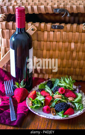 healthy picnic with red wine and a berry and nut salad - Stock Photo