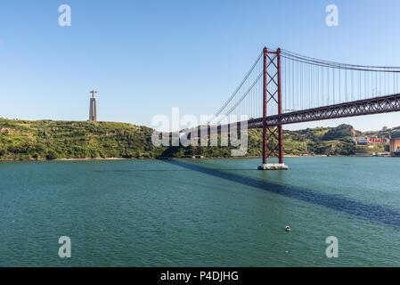 Lisbon, Portugal - May 19, 2017: The 25 April bridge (Ponte 25 de Abril) is a steel suspension bridge located in Lisbon, Portugal, crossing the Targus - Stock Photo