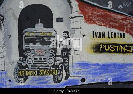 Graffitis to remember memorial of heroes of war civil-war in Yugoslavia  yougoslavia-war Vukovar street. Split, Croatia - Stock Photo