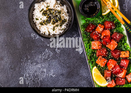 Poke, traditional Hawaiian raw fish salad, top view. - Stock Photo