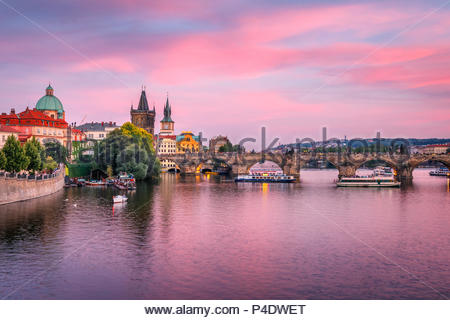 Purple sunset over Charles Bridge, Prague, Famous iconic panorama - Stock Photo