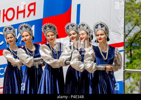 Russia, Vladivostok, 06/12/2018. Beautiful ladies in traditional Russian costumes perform on stage in a honor of Russia Day. Annual celebration Russia - Stock Photo