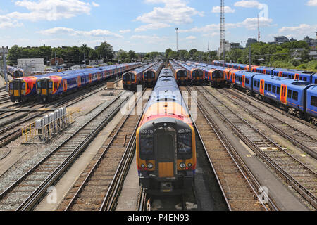 Newly rebranded South Western Railways type 450 rolling stock stored on sidings at Clapham Junction Station in south London, UK - Stock Photo