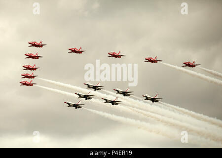 The Red Arrows flying with The Thunderbirds display team - Stock Photo