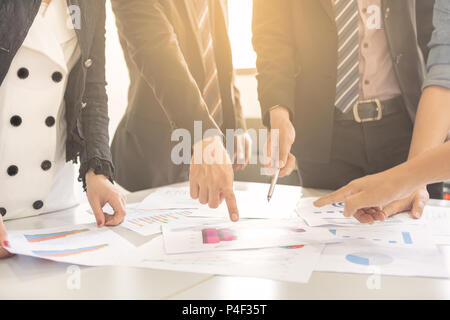 Businessman and woman are brainstorming on to creative new business idea as teamwork concept. - Stock Photo