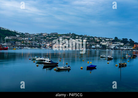 The Fowey Estuary looks like a skating rink in the calm waters just before dawn looking across to Polruan from Fowey. - Stock Photo