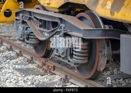 Closeup view of the wheels of a railway wagon. Selective focus. - Stock Photo