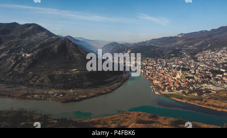 scenic view of river, mountains and beautiful city in Georgia - Stock Photo