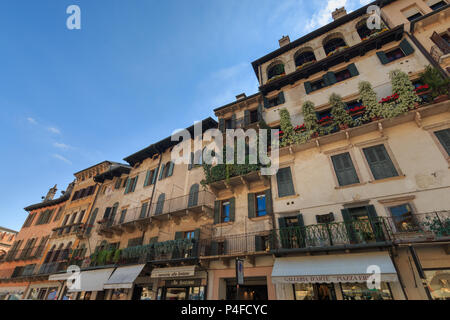 Verona, Italy – May 26, 2017: Residential buildings and shops at Piazza Erbe in the Italian city of Verona - Stock Photo