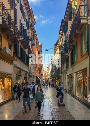 Verona, Italy – May 26, 2017: People in a colorful pedestrian zone in the center of Verona, Italy - Stock Photo