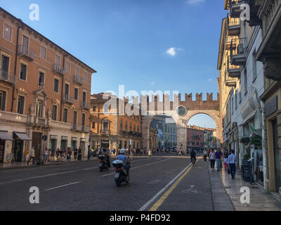 Verona, Italy – May 26, 2017: A marble and red-brick gateway called Portoni della Bra with an impressive clock is leading to Pizza Bra in the Italian  - Stock Photo