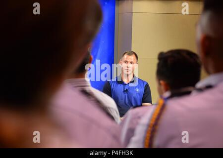 Col. Nick Hague, NASA astronaut, discusses his upcoming trip to the International Space Station, during a news conference at the Johnson Space Center in Houston, June 18, 2018. Hague and Alexey Ovchinin, Russian Roscosmos cosmonaut, will journey to the ISS on Oct. 11, 2018, aboard the Roscosmos Soyuz MS-10 spacecraft, launched from Baikonur Cosmodrome in Kazakhstan. (U.S. Air Force photo by Tech. Sgt. R.J. Biermann) - Stock Photo