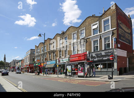 Norwood Road, South London, UK. The main shopping street in West Norwood. Shows stores, shoppers and light traffic in this busy urban area. - Stock Photo
