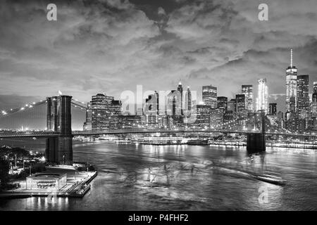 Black and white picture of New York cityscape at night, USA. - Stock Photo