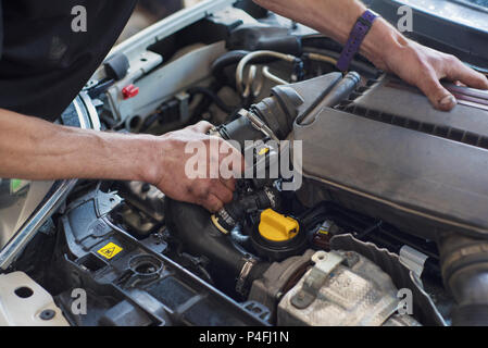 Auto mechanic repairing car. Selective focus. - Stock Photo