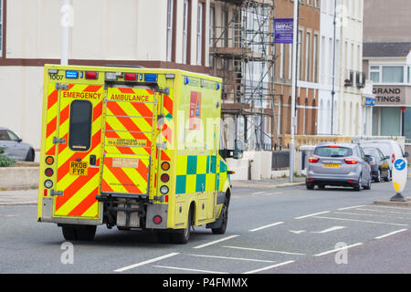 An ambulance responds to an emergency as a car in front brakes to let him by, hastings, east sussex, uk - Stock Photo