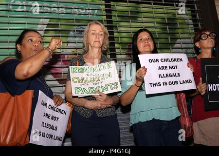 """New York City, New York, USA. 21st June, 2018. Hundreds of New Yorkers assembled at a newly discovered detention facility named Cayuga Children's Center in Harlem, for a silent vigil as an expression of demand that the children be reunited with their families ''"""" and not be held in concentration camps by the government of the United States. The ''˜zero tolerance policy' has angered Americans, resulting in the Trump administration reversal of the policy today, 21st. June, 2018. Credit: G. Ronald Lopez/ZUMA Wire/Alamy Live News - Stock Photo"""