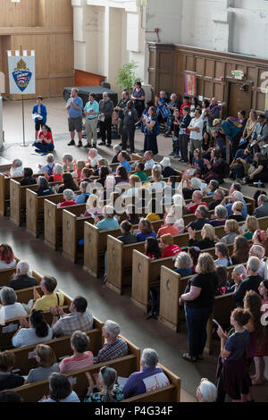 Seattle, USA. 21 June 2018. Hundreds of supporters gathered at St. Mark's Episcopal Cathedral in Capitol Hill for an interfaith prayer and vigil in support of migrants and asylum-seekers who come to the U.S. and to protest the inhumane separation of children from their parents. The two mile 'Prayer and Procession for Families at the Border' began at Saint Mark's Episcopal Cathedral in ended at St. James Roman Catholic Cathedral in First Hill. Credit: Paul Christian Gordon/Alamy Live News - Stock Photo