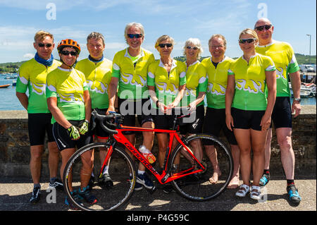Schull, Ireland. 22nd June, 2018. A group of cyclists are cycling from Malin Head at the top of Ireland to Mizen Head in the south west. The friends, all from County Down are undertaking the cycle in aid of Cancer Research and Prostate Cancer. With 400 miles down and only 20 to go, they are pictured here taking a break in Schull before they finish the ride today. Credit: Andy Gibson/Alamy Live News. - Stock Photo