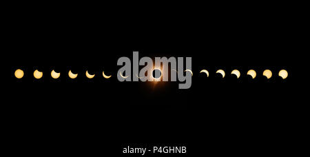 Sequence of total solar eclipse 2017 with exposures bracketed and combined to enhance the solar corona at totality. - Stock Photo