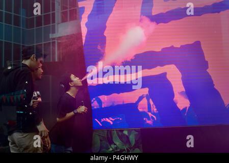 Vape artists performing cloud tricks during Jakarta Vape Fest 2018 in Jakarta, Indonesia. - Stock Photo