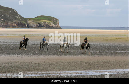 Four horses and riders on the beach at Dunfanaghy County Donegal Ireland - Stock Photo