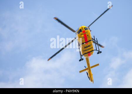 FELDKIRCHEN / GERMANY - JUNE 09, 2018: Eurocopter EC-135 from ADAC Luftrettung flies over landing side. Notarzt means emergency doctor. - Stock Photo