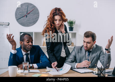 Interracial businesspeople having discussion in modern office - Stock Photo